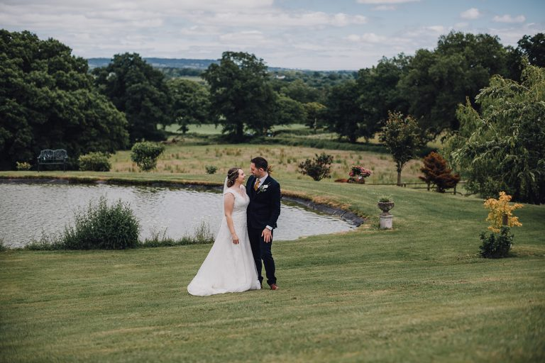Bride and groom with Devon countryside in the background